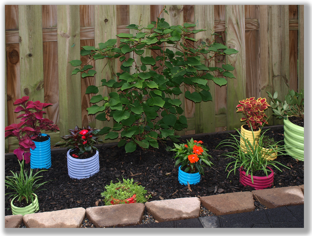 Photograph of fun colorful planters in a yard