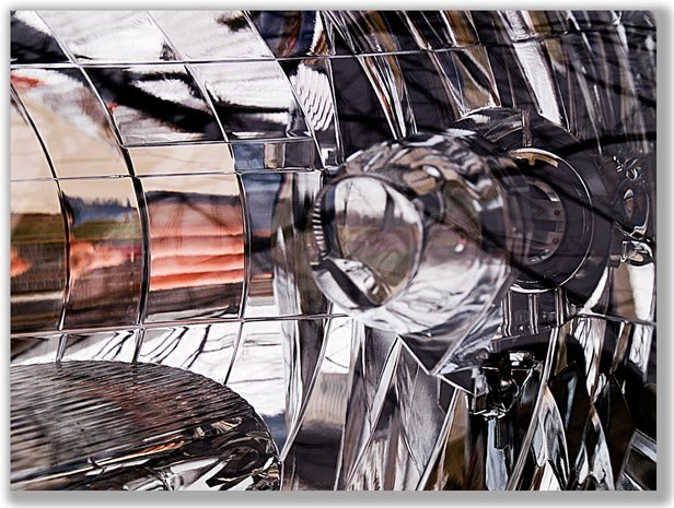 Photograph of the many reflections in a car headlight