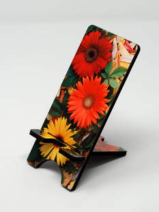 Phone stand of red,yellow, and orange gerbera daises