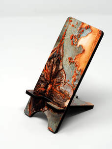Phone stand showing tree bark