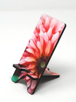 Phone stand showing a pink dahlia