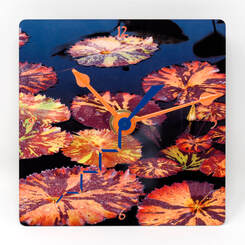 Clock featuring foxfire tropical lily